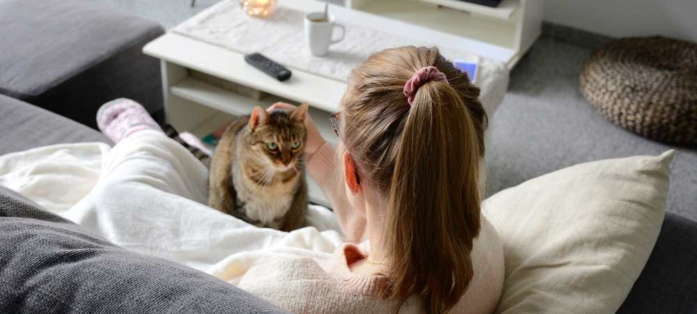 girl on couch with cat